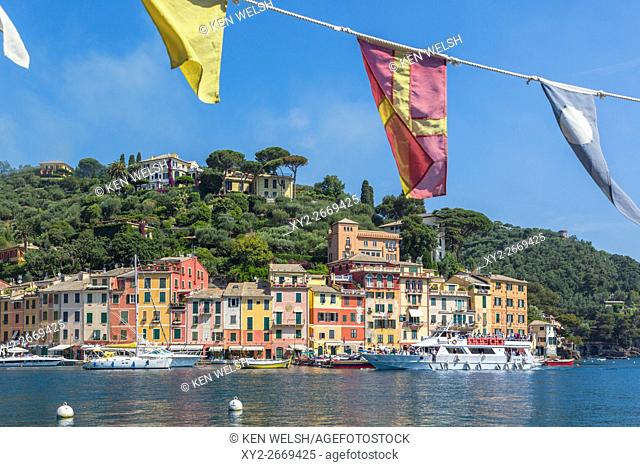 Portofino, Genoa Province, Liguria, Italian Riviera, Italy. Boats in the harbour with the village behind