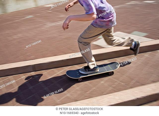 Close-up of a preteen boy skateboarding
