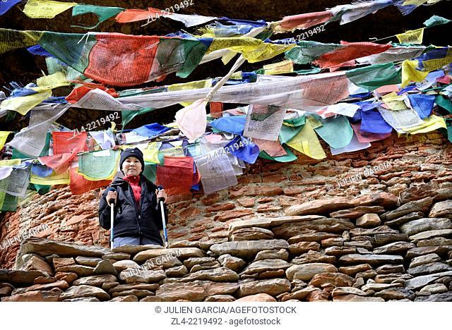 Prayer flags at Chungsi gompa, Padmasambhava's meditation cave. Nepal, Gandaki, Upper Mustang (near the border with Tibet). Model Released