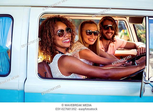 Friends travelling in campervan