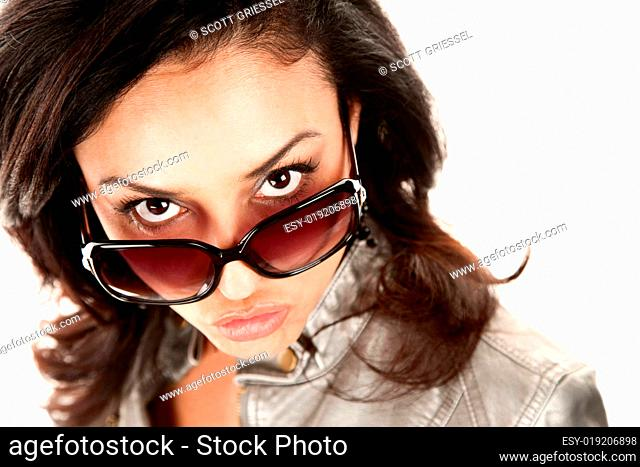 Pretty Latina Woman Looking Over Her Glasses