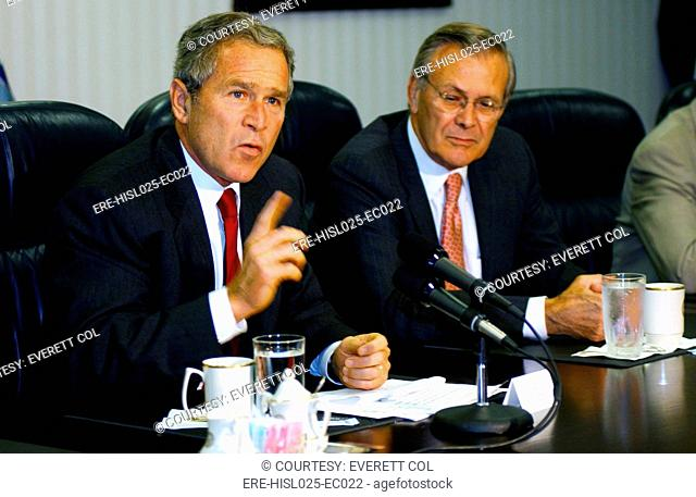 U.S. President George W. Bush answers a question about Osama bin Laden during a press conference held after meeting with U.S