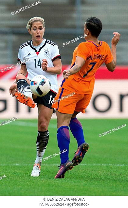 Germany's Anna Blaesse (L) and the Netherland's Shanice van de Sanden vie for the ball during the women's international soccer match between Germany and the...
