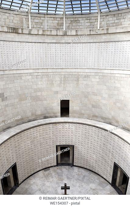 Central tower with skylight cross and names of the interred at the World War I memorial at Oslavia Italy