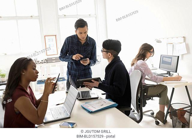 Business people using technology in office