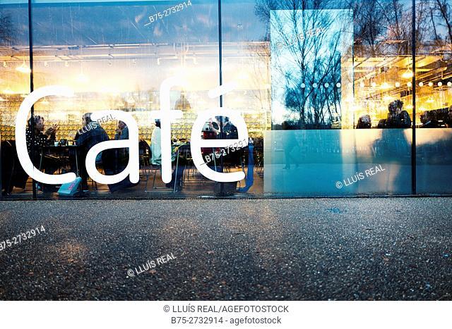 Reflections on Tate Modern's coffee shop window, Bankside, London, England