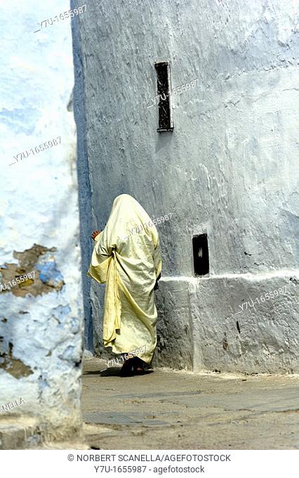 North Africa, Tunisia, Kairouan. Holly city. Man walking in the medina