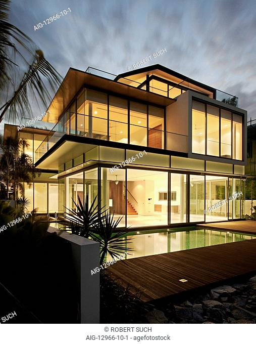 Modern glass house at dusk