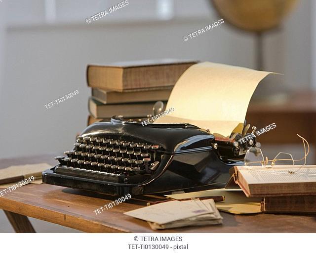 Antique typewriter on table