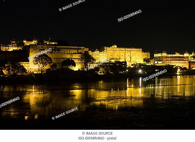Night view of city palace and lake pichola