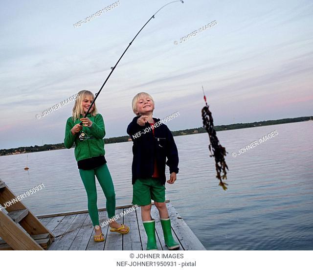 Children fishing, Karlskrona, Blekinge, Sweden