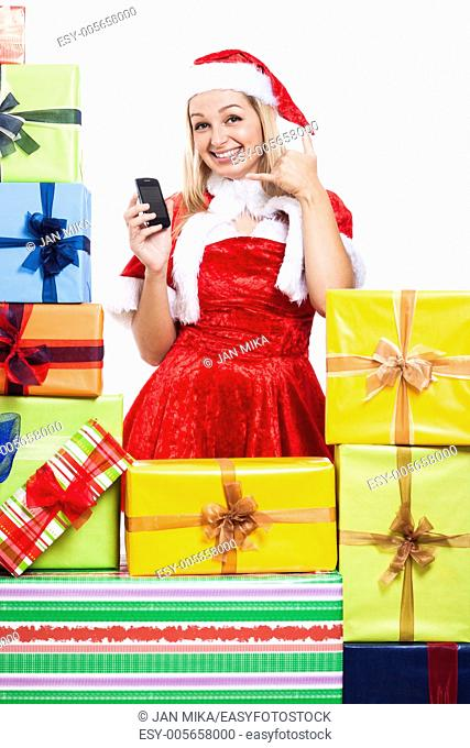 Happy woman in Christmas costume going to call you, isolated on white background