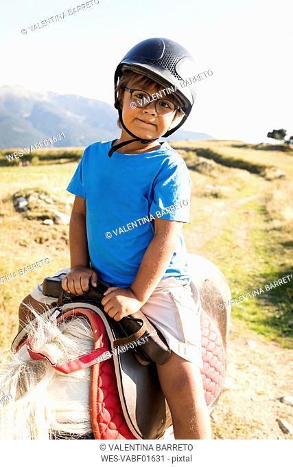 Spain, Cerdanya, portrait of little boy riding on pony