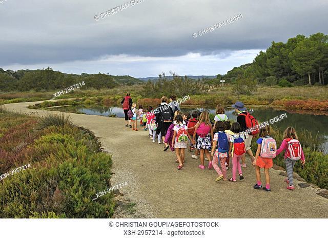 children walking around in the lagoon of s'Albufera des Grau Natural Park, Menorca, Balearic Islands, Spain, Europe