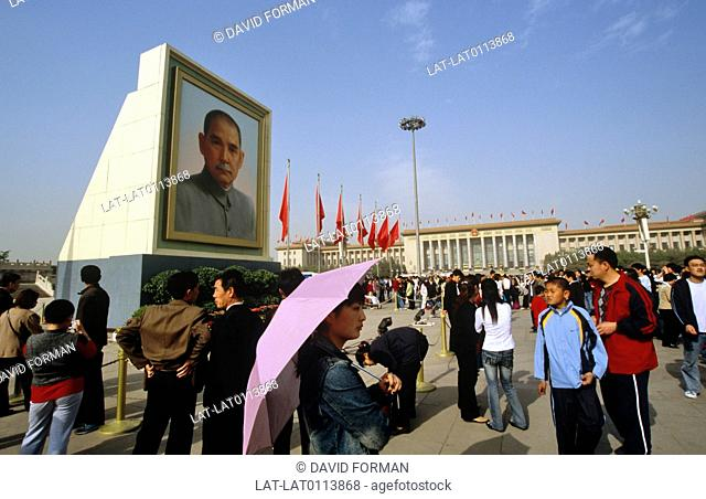 Tiananmen Square. Huge public square. Of historical and political significance. May Day parades. Posters. Images. Flags. People. Public celebration