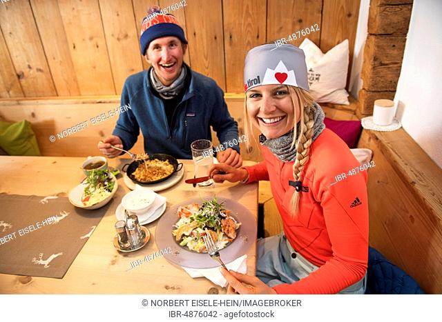 Skiers having lunch in a hut, Hohe Salve, Hopfgarten, Tyrol, Austria