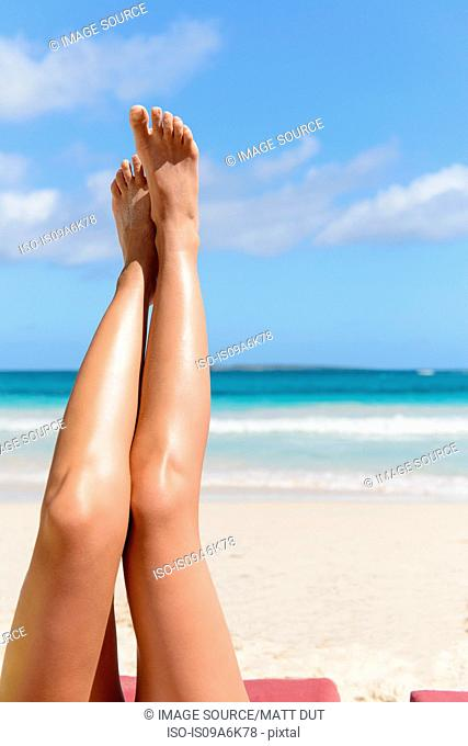 Woman's legs on tropical beach
