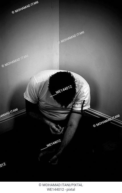 Man injecting heroin drugs