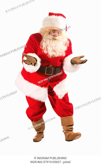 Happy Christmas Santa Claus with a funky welcome gesture. Isolated on white background. Full length