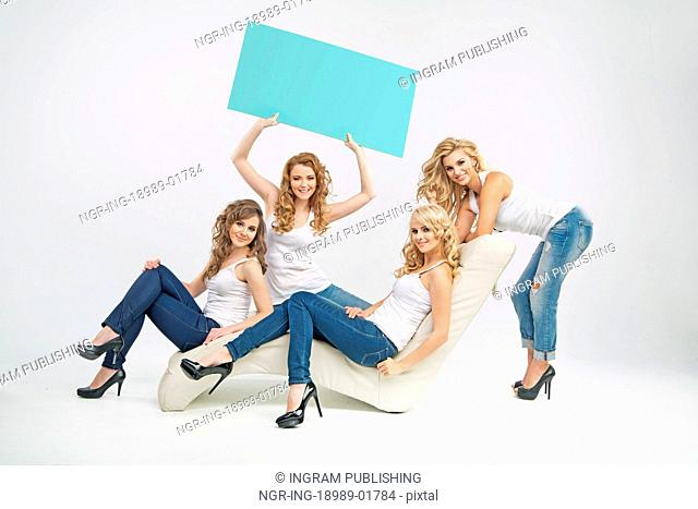 Sensual young women sitting with colorful boards