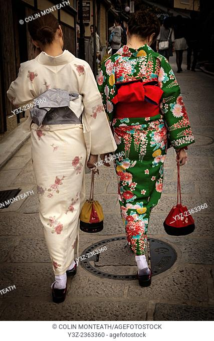 Japanese women wearing traditional kimonos while shopping, Kyoto, Japan