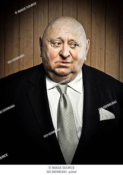 Studio portrait of sad senior man