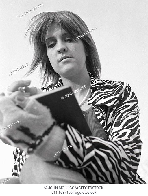Woman with zebra coat, writing in journal