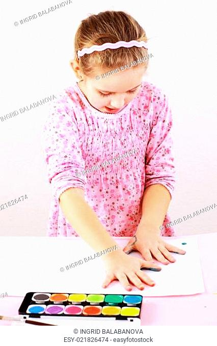 Cute girl painting with watercolor