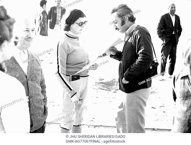 Various people talk and working during a 1974 archaeological expedition to the Arabian Gulf, 1974