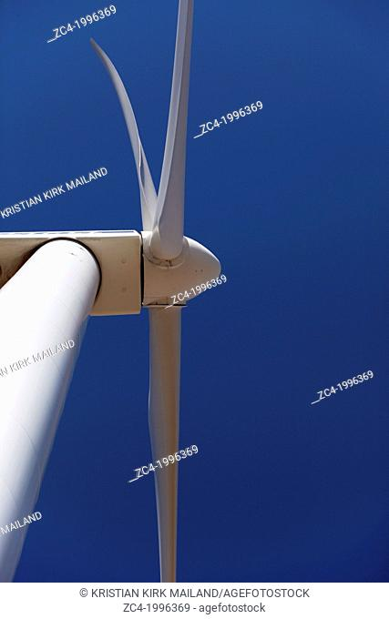 Wind turbine, close against blue sky