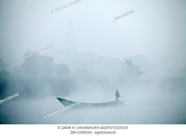 Boat on the river meghna in winter morning