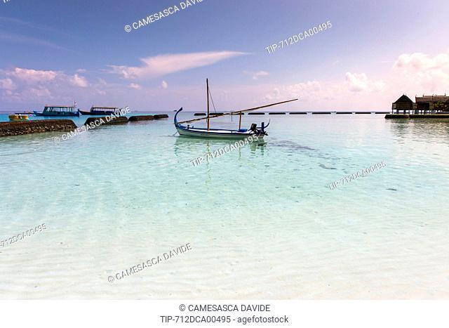 Maldives, Ari Atoll, Constance Moofushi Resort, A boat in the beach