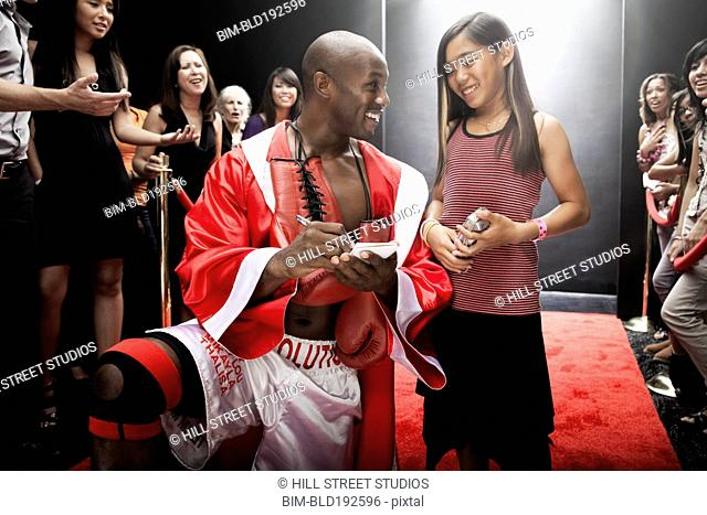 Boxer signing autograph for fan