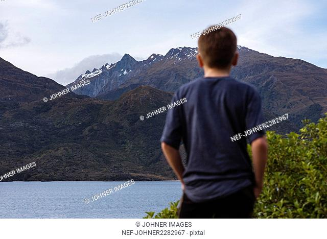 Boy looking at view