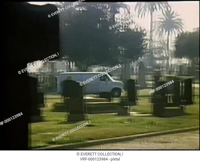 Wide shot van driving through cemetery5