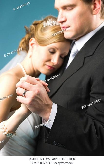 Bride and groom dancing, very narrow depth of field and focus on the ring