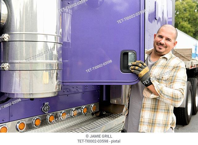 Truck driver and purple semi-truck