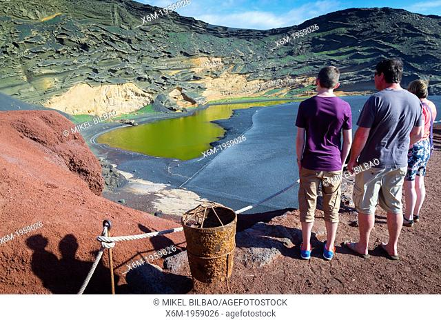 People, crater and pool. Charco de los Ciclos