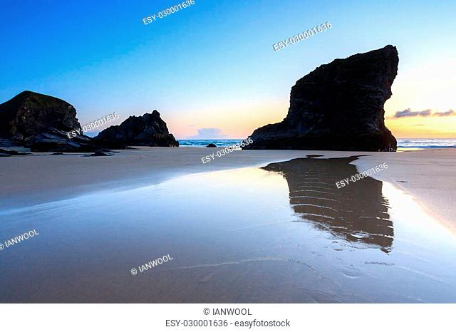 Sunset on the golden sandy beach at Bedruthan Steps Cornwall England UK Europe