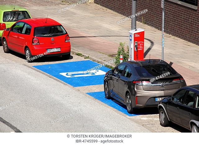 Car park in front of an electric car charging station, Germany