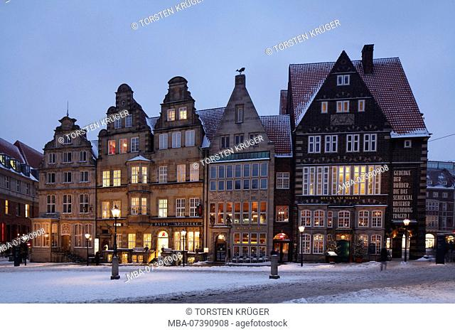 Historic row of houses with snow at the market square with market square West side at dusk, Bremen, Germany, Europe
