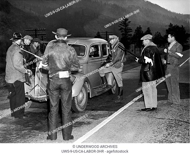 Verdi, Nevada: October 10, 1938.A group of armed possemen stopping motorists coming into Nevada near the state line on Highway 50