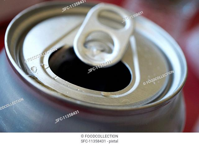 An open can of fizzy drink
