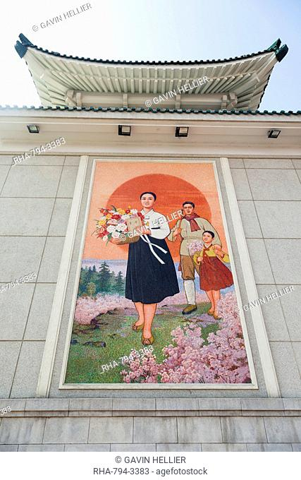 Colourful wall paintings outside the National Theatre, Pyongyang, Democratic People's Republic of Korea DPRK, North Korea, Asia