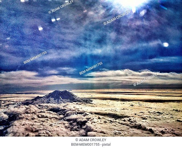 Mount Rainier mountaintop over cloudy sky, Seattle, Washington, United States