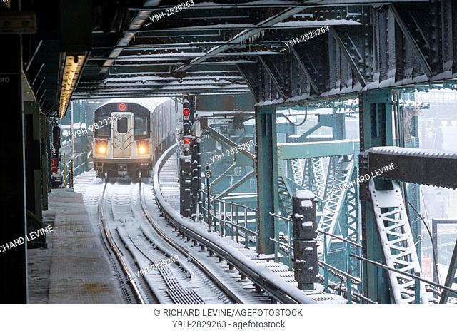 A Flushing Line train arrives at the Queensboro Plaza station in New York during the city's first major winter storm of the season