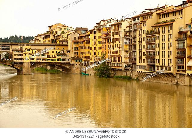 Houses and part of the Ponte Vecchio overlooking the River Arno in Florence, Tuscany, Italy