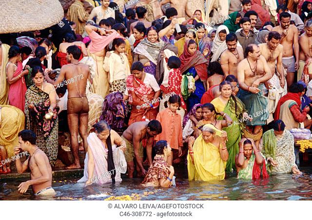 People bathing on the ghats on the day of Makar Sankranti. The Ganges. Varanasi. India