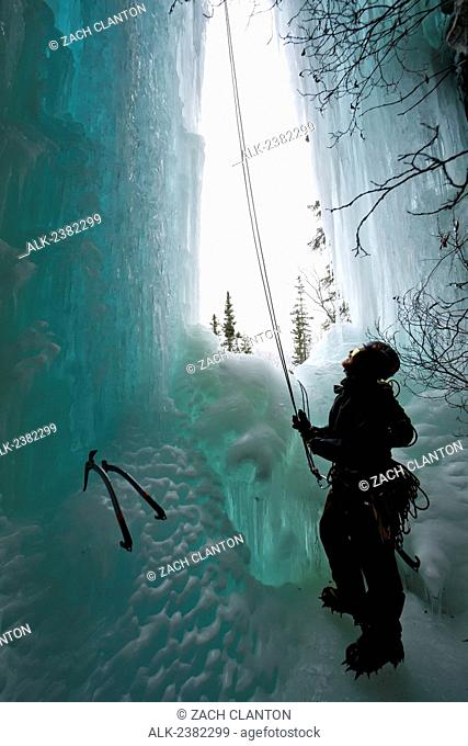 Ice climber in a waterfall cave in Thompson Pass, Valdez, Alaska