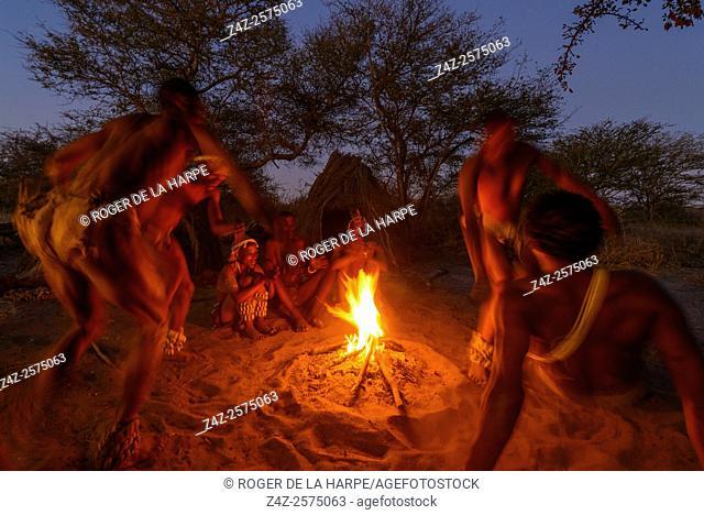 San or Bushman men dancing around a fire. Haina Kalahari Lodge. Botswana